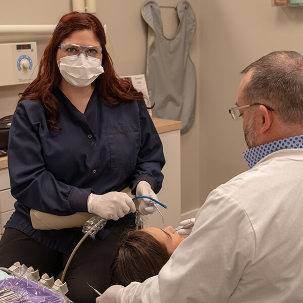 One of our dental hygienists assisting Dr. Pratt during a treatment