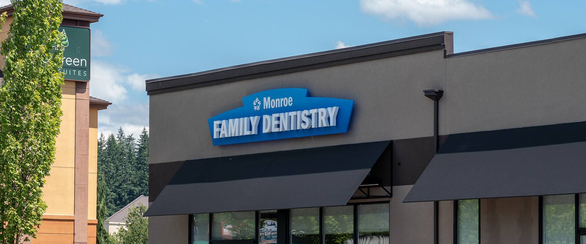 The Monroe Family Dentistry building exterior with our logo above the door